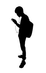 Silhouette image. Young man backpack is using smartphone for listening music. This has clipping path.