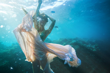 Beautiful fashion model underwater