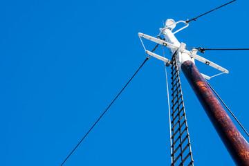 sailboat mast against blue sky