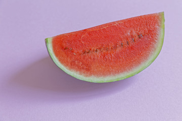 pieces of watermelon on pink background