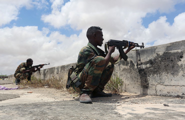 Members of Somali Armed Forces take their position during fighting between the military and police backed by intelligence forces in Mogadishu