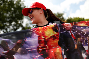 Activist holds a Trump flag during the Mother of All Rallies demonstration on the National Mall in Washington