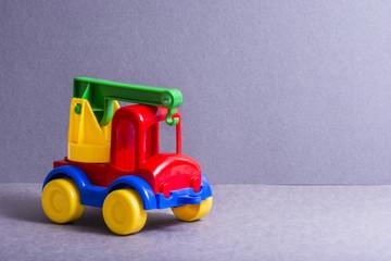 Toy truck. Toys for little children. Crane.