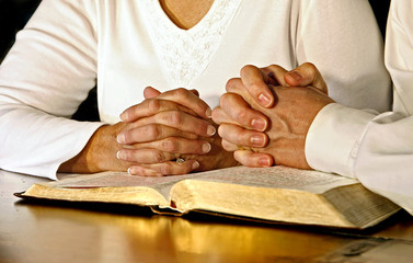 Couple Praying with Holy Bible