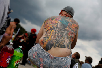 Demonstrator with an ICP-themed tattoo looks on during the Juggalo March in Washington