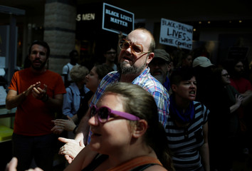 People march through West County Mall after the not guilty verdict in the murder trial of Jason Stockley in St. Louis