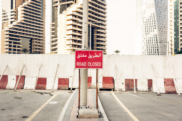 Road Closed Sign With Latin And Arabic Letters