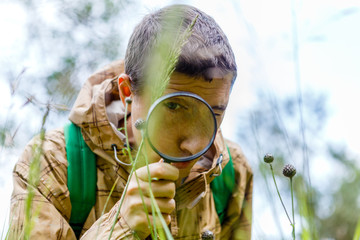 Picture of environmentalist man with magnifying glass