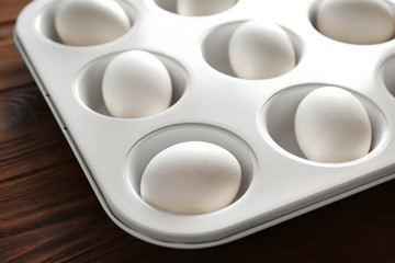 Hard boiled eggs in muffin tin on table