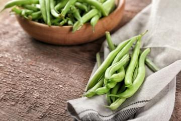 Fresh green beans on napkin