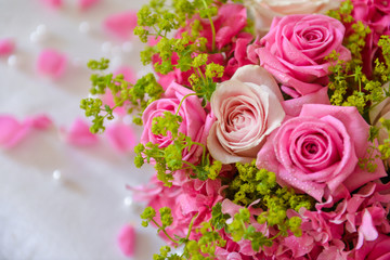 floral composition with a pink roses
