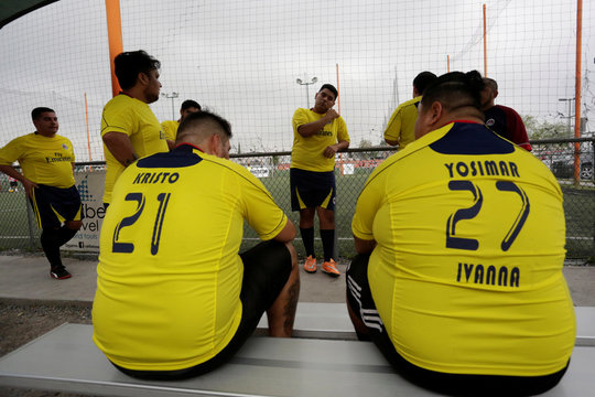 """Players talk as they wait to play their """"Futbol de Peso"""" (Soccer of Weight ) league soccer match, a league for obese men who want to improve their health through soccer and nutritional counseling, in San Nicolas de los Garza"""