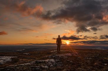 Man standing in scenic sunrise
