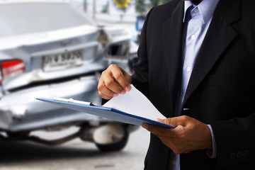 Car insurance agents open clipboard as a proof of insurance claim for car accident damaged