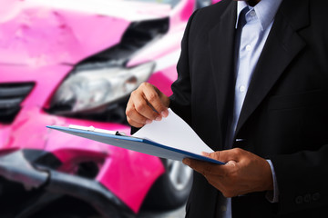 Car insurance agents open clipboard as a proof of insurance claim for taxi car accident damaged