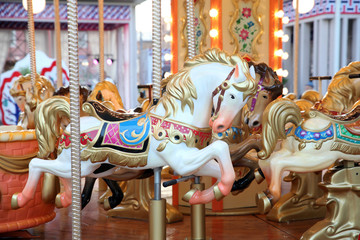 Children's carousel with horses at the festival