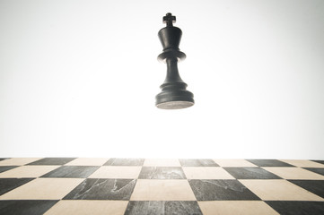 A chess piece, king in the air