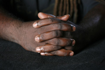 Closeup of hands of African American man