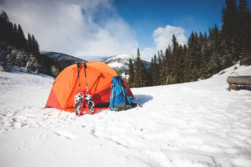 camping in the winter in the mountains.