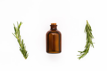 fresh rosemary with oil bottle on white background