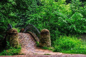Old stone bridge in the city park