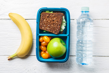 Image of fitness breakfast in box, bottle of water
