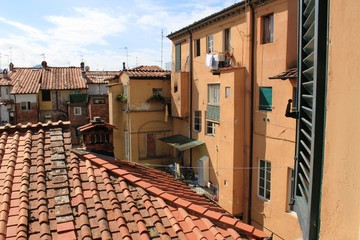View from the window. Roofs and architecture of houses in Italy.