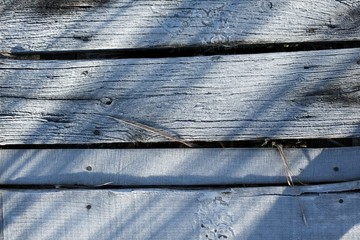 Wooden deck covered by ice crystals