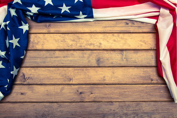 American flag on wooden background with a toning effect.The Flag Of The United States Of America. Template.The view from the top.