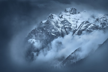 Moody foggy scene on mountain peaks in Tyrol