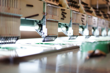 Textile sewing machines in factory hall