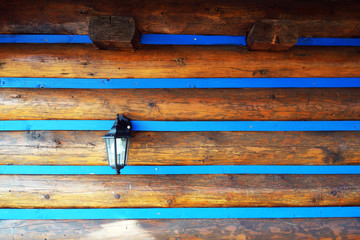 Electric lamp on a wooden wall