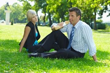 Businessman on lunch break sitting in grass