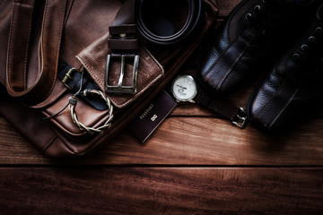Men's leather accessories and passport on rustic wooden background, fashion and beauty, travel concept