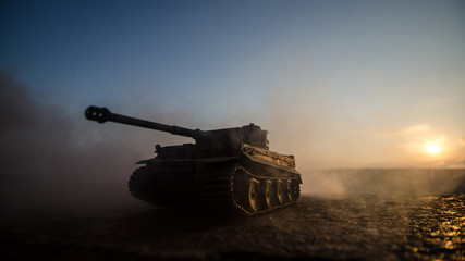 War Concept. Military silhouettes fighting scene on war fog sky background, World War Soldiers Silhouettes Below Cloudy Skyline at sunset. Armored vehicles. German tank in action