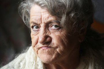 Elderly woman sad face