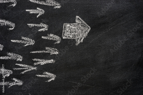 leadership arrow on chalkboard background stock photo and royalty