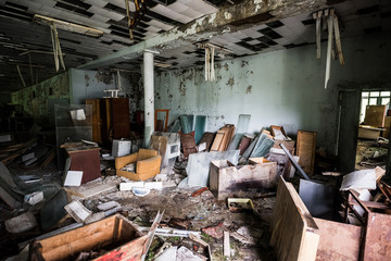 room with debris in abandoned community center in Pripyat, Chernobyl, Ukraine