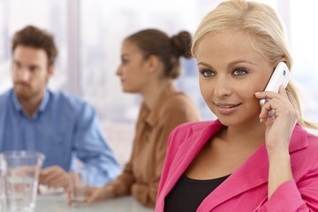 Beautiful businesswoman talking on mobile