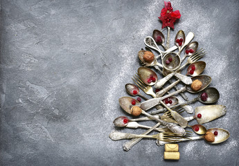 Abstract christmas tree made from cutlery.Top view with copy space.