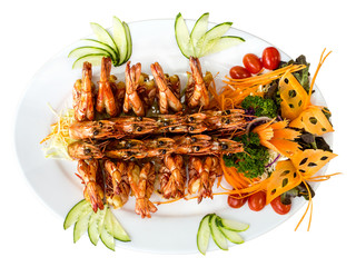 Plate of grilled prawns - isolated on white. Top view