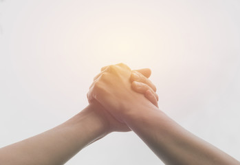 Two hands reaching toward each other. Teamwork and helping concept.