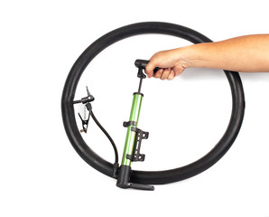 hand pumping air into bike tire