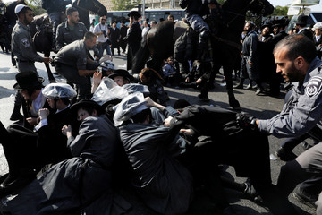 Israeli ultra-Orthodox Jewish men clash with police at a protest against the detention of a member of their community who refuses to serve in the Israeli army, in Jerusalem
