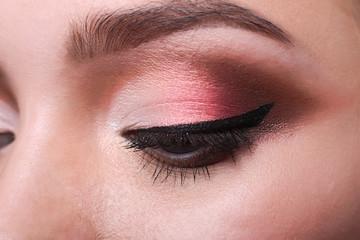 Eye with bright makeup closeup, model face crop