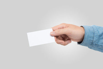 Male hand holding blank business card isolated