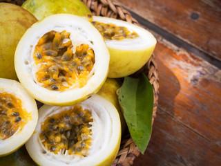 Passion fruit in bamboo basket. Tropical fruit. Sour taste, higth vitamin. Diet dessert.