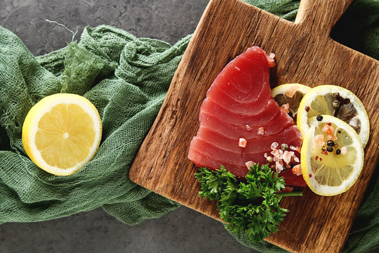Steak of tuna for grilling. Dark background. Seafood.