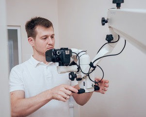 Microscope with photo camera in the dental office