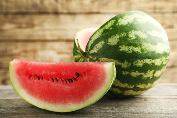 Slice of watermelon on brown wooden table